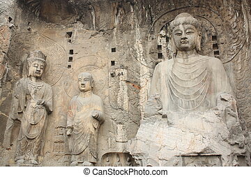 Longmen Caves in Luoyang - Longmen Grottoes with Buddhas...