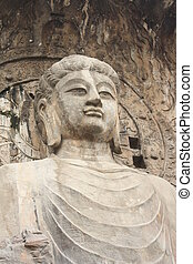 Longmen Caves in Luoyang Buddha - Longmen Grottoes with...