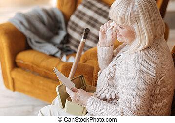 Sad cheerless woman having nostalgic memories - I will never...