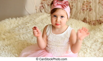 Beautiful funny happy child is playing Waving handles -...