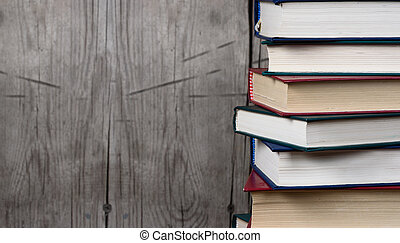 stack of books over wooden background. Copy space