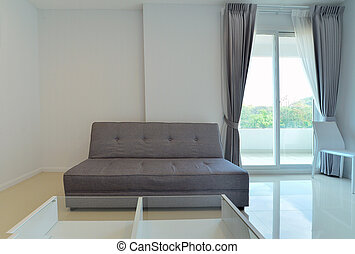 modern sofa in white living room with window, interior design