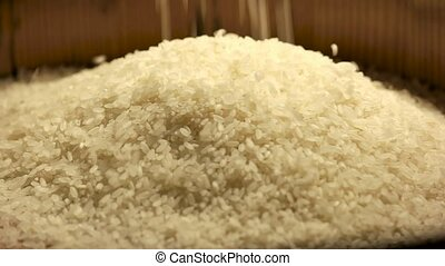 Pile of rice closeup. White groats falling. Grains market...