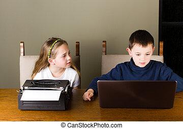 Kids working on old typewriter and laptop