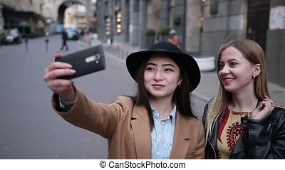 Multiethnic friends having fun and taking selfie -...