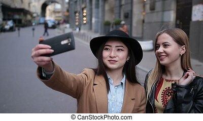 Multiethnic friends having fun and taking selfie -...