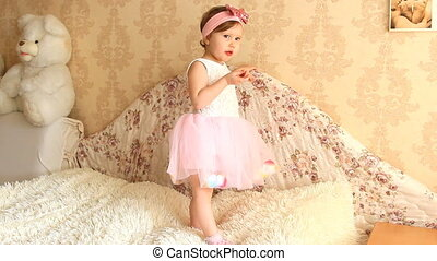 Beautiful funny happy child is playing and having fun....
