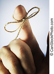 Remember! - A piece of string tied around index finger