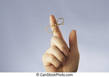 Don't forget to... - A string tied around an index finger