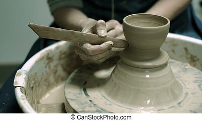 Clay potter creating on the pottery wheel 4k - Clay potter...