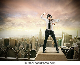 Businessman on rooftop - Businessman dancing on rooftop