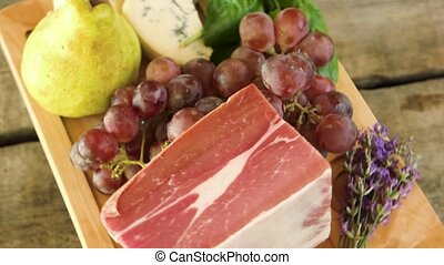 Raw food on wooden board. Frozen meat and cheese. Protein...