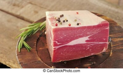 Piece of frozen beef. Meat on old wooden plate. Rustic...