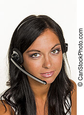 woman with headset - a young woman in a customer on the...
