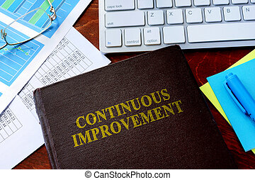 Book with title continuous improvement. - Book with title...