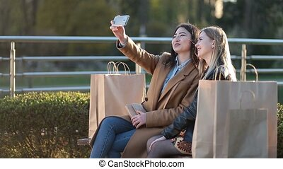 Teenage girls making self portrait with phone - Happy best...