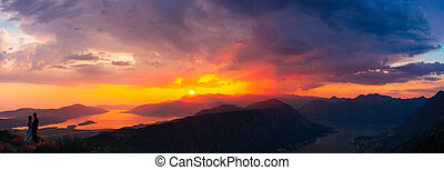 Silhouettes at sunset on Mount Lovcen
