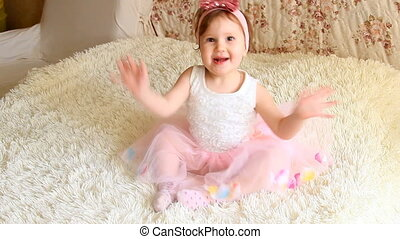 Beautiful funny happy child is playing and waving his hands...