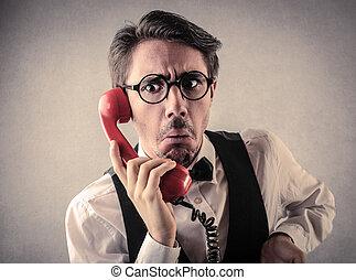 Suprised businessman on phone