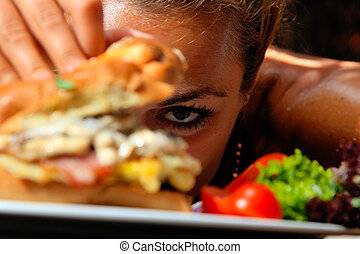 Eating a yummy cheeseburger - Woman eating a yummy...