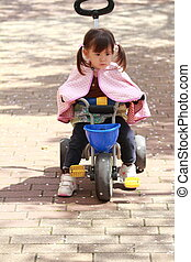Japanese girl riding on the tricycle (2 years old)