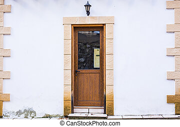 A front entrance of a home with a door