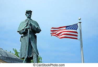 Civil war monument with American flag - The statue of a...