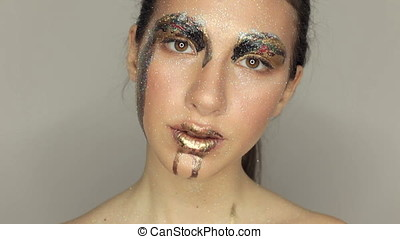 Woman with conceptual make up in studio