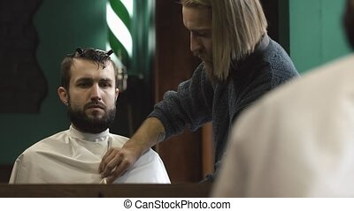 Hairdresser preparing for a patient's haircut in the Barbershop