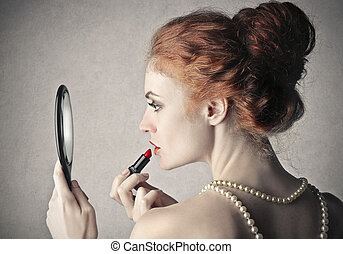Woman and lipstick - Woman putting lipstick on