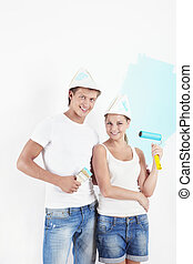 Repairs - Young couple making repairs in the apartment