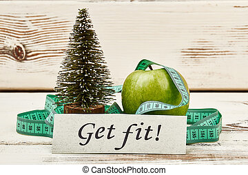 Fir-tree, apple, tape and card. New year and new you.