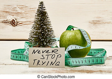 Fir-tre, motivation card and apple. Mistakes are proof of...