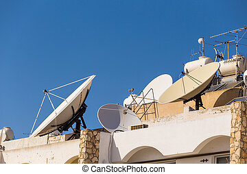 Satellite dish on the roof. - Satellite dish with sky on the...