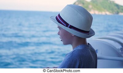 a child stands on a floating ship and looks into the distance