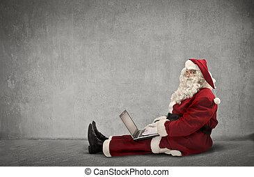 Santa with laptop - Santa working on laptop