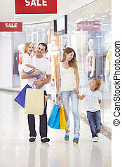 Family Shopping - Family with two children in the store