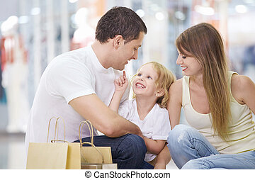 Young family - A happy family with a child in the store