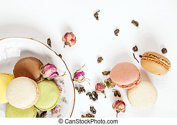 Multicoloured macaroons and tea - Multicoloured macaroons on...