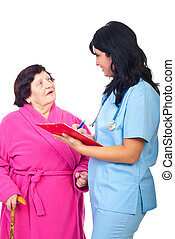 Doctor write prescription to elder woman - Smiling doctor...