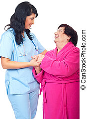 Caring doctor holding elderly woman hands - Caring doctor...