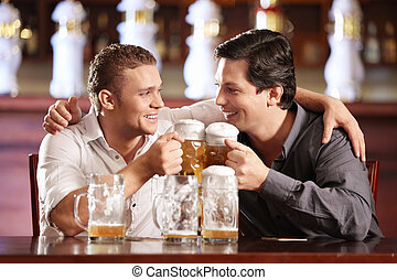 Drunken cheerful man in a pub - Two drunken gay men with a...