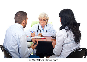 Couple visiting doctor in office - Young couple visiting...