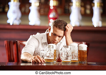 Drunk man in a pub - Drunk man with a beer in a pub