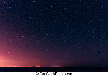 Colorful Night Starry Sky Above The Yellow City Lights....