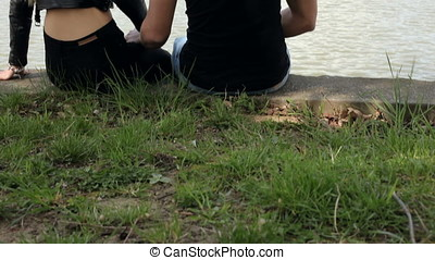 Young couple on the edge of the lake