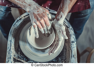 Body part - Hands on a potter's wheel