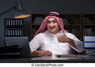 Arab businessman working late in office