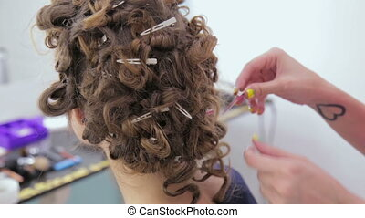 3 shots. Hairdresser finishing hairstyle for teen girl - 3...