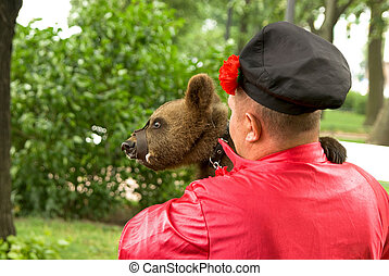 Circus bear on walk with the trainer